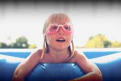 Blond little girl playing in the pool Stock Photo