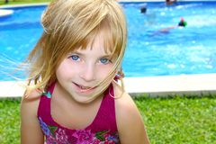 Blond little girl pool vacation smiling portrait Stock Photography