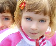 Blond little girl portrait funny gesturing face Stock Images