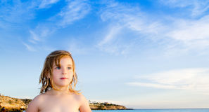 Blond little girl portrait in Ibiza beach Royalty Free Stock Image