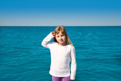 Blond little kid girl sailing in a boat Royalty Free Stock Photo