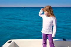 Blond little kid girl sailing looking away Royalty Free Stock Image