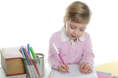 Blond little student girl writing desk Royalty Free Stock Photo