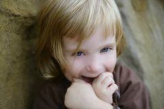 Blond little toddler girl with funny gesture Royalty Free Stock Images