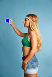Blond long hair girl with jeans shorts selfie photo Stock Images