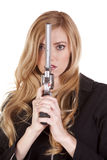 Blond looking around gun Royalty Free Stock Photo
