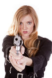 Blond looking down a gun Stock Photos