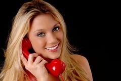 blond älskvärd telefonkvinna Royaltyfri Foto