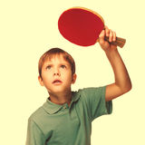 Blond man boy playing table tennis forehand takes topspin isolat Stock Photo
