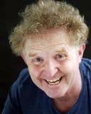 Blond man för stående som skrattar uttryck Royaltyfri Bild