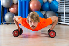 Blond man gym push-up pushup dumbbells Royalty Free Stock Photo