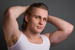 Blond man over gray background Stock Photos