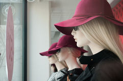 Blond mannequin with red hat Stock Photography