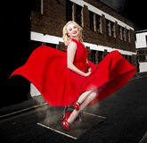 Blond Marilyn Monroe pinup girl in retro dress Stock Image