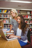 Blond mature student helping her classmate Royalty Free Stock Image
