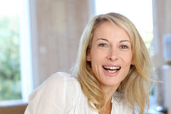 Blond mature woman at home Stock Photography