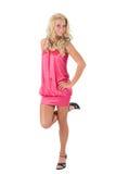 Blond meisje dat zich op één voet bevindt Royalty-vrije Stock Fotografie