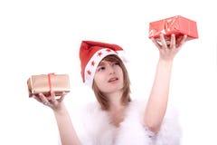 Blond meisje in de hoed van de Kerstman   Stock Fotografie