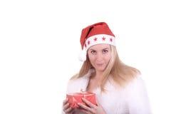 Blond meisje in de hoed van de Kerstman met gift Royalty-vrije Stock Foto's