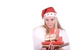 Blond meisje in de hoed van de Kerstman met gift Royalty-vrije Stock Fotografie