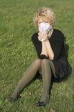 Blond meisje met geld Stock Foto's