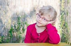 Blond meisje met glazen Royalty-vrije Stock Fotografie
