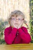 Blond meisje met glazen Royalty-vrije Stock Afbeelding