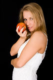 Blond meisje met rode appel Royalty-vrije Stock Afbeeldingen