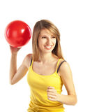Blond meisje met rode bal stock foto