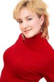 Blond meisje in rood stock fotografie