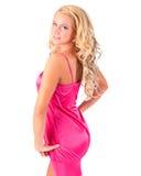 Blond meisje in roze uniformjas royalty-vrije stock afbeeldingen