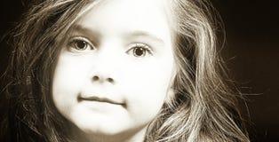 Blond meisjesgezicht in sepia royalty-vrije stock foto