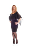 Blond  middle age woman in black dress. Royalty Free Stock Photo