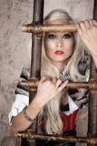 Blond mit Strichleiter Stockfoto