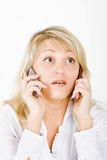 Blond with mobile phones Royalty Free Stock Image