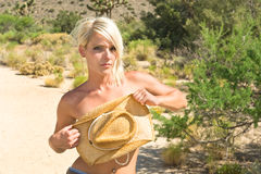 Blond model in desert Royalty Free Stock Image