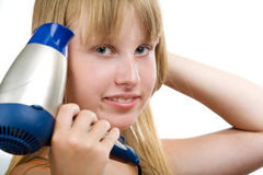 Blond model with hairdryer Royalty Free Stock Photography