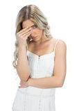 Blond model having headache touching her forehead Royalty Free Stock Photography