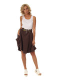 Blond model with luxury hair and brown skirt isolated Stock Image