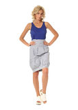 Blond model with luxury hair and gray skirt isolated Stock Image