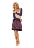 Blond model with luxury hair and purple skirt isolated Stock Images