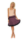 Blond model with luxury hair and purple skirt isolated Stock Photography