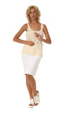 Blond model with luxury hair and white skirt isolated Royalty Free Stock Photo