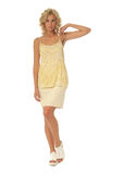 Blond model with luxury hair and yellow skirt isolated Stock Images