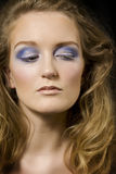 Blond model with makeup. Close-up of beautiful blond model with dramatic eyeshadow stock photography