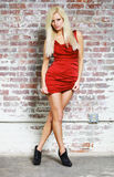 Blond model in red dress Stock Photo