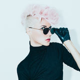 Blond model in vintage glasses with stylish haircut. fashion pho Stock Photos