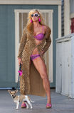Blond Model Walking Dog Royalty Free Stock Photo