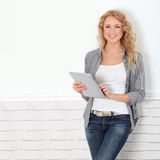 Blond modern girl with tablet Stock Image