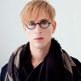Blond modern student man with nerd glasses Stock Photos